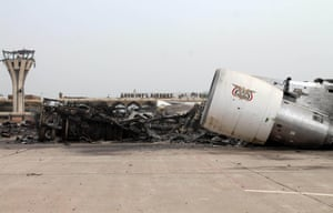 The debris of a plane is photographed on the tarmac at Aden's international airport. Military sources reported that loyalists of Yemen's exiled president recaptured the airport after a four-month battle with Shiite Huthi rebels, aided by Saudi-led air and naval support.