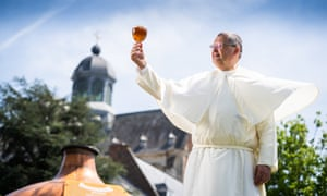 Norbertine Father Karel toasts with a Grimbergen beer.