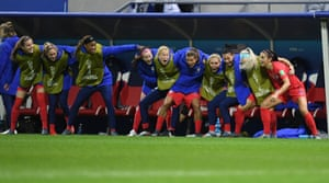 Alex Morgan of USA celebrates with the team bench after scoring her side's twelfth goal.