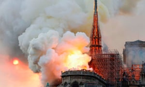 Smoke and flames rise during the fire at Notre-Dame Cathedral in Paris