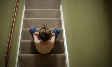 A child sits alone on stairs