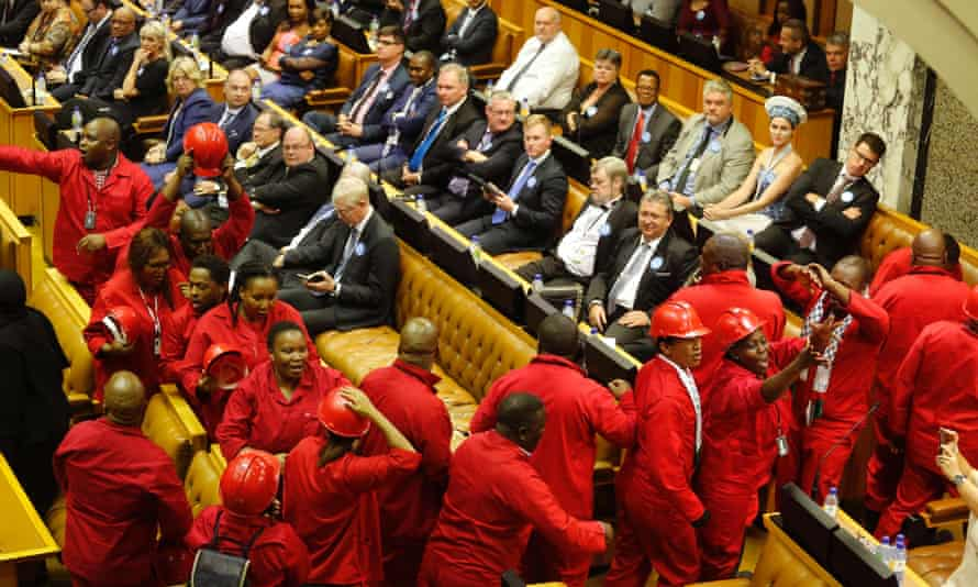 Members of the Economic Freedom Fighters party leave parliament as during Jacob Zuma's state of the nation address.