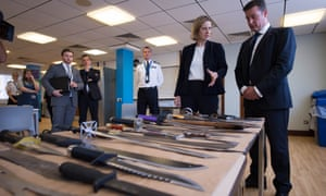 The home secretary, Amber Rudd, at Southwark police station in London this month. There has been a 20% surge in gun and knife crime.
