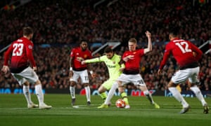 Manchester United's Scott McTominay stops Barcelona's Lionel Messi.
