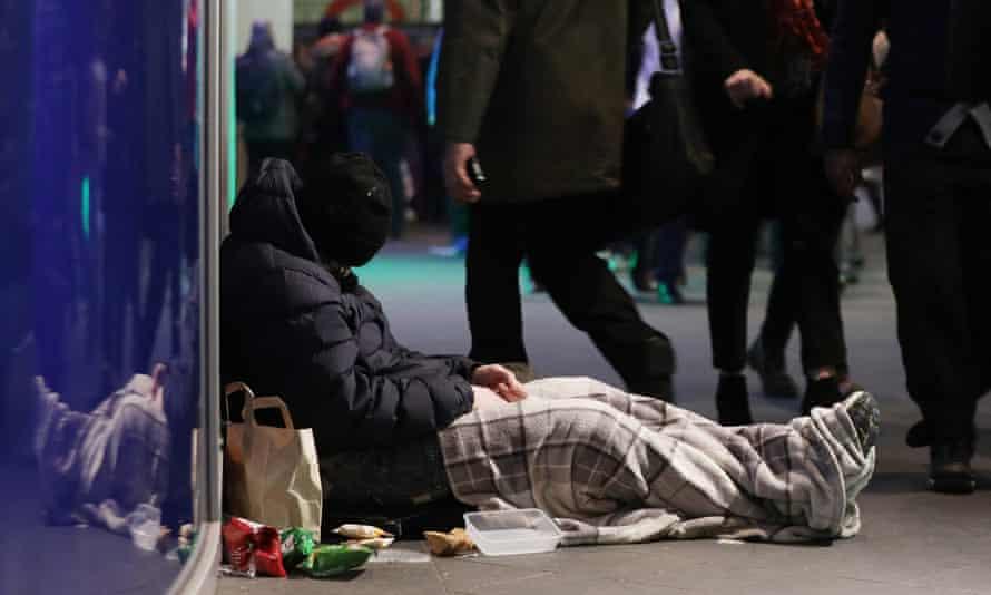 Man sleeping on street.
