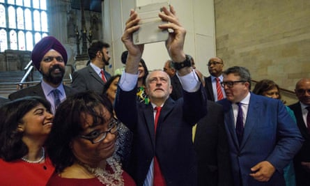 Jeremy Corbyn takes a selfie with Labour MPs in Westminster Hall at the Houses of Parliament in central London on 28 June.