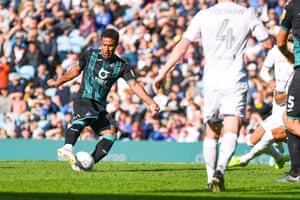 Swansea City midfielder Wayne Routledge scores to give the visitors the lead.
