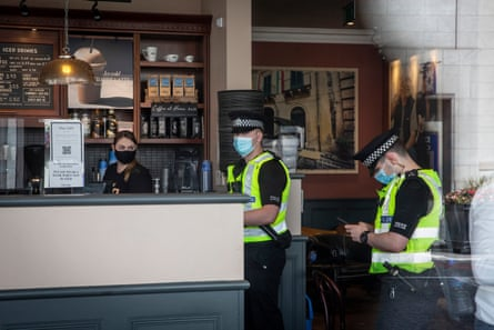 Police make checks in a coffee shop on Union Street