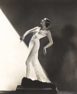 Woman wearing sheer evening gown. Courtesy of Old Visuals Everett Collection Mary Evans