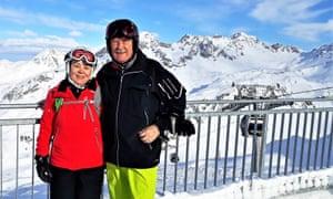 Sieglinde Schopf and her husband Hannes Schopf, a retired journalist, posing near the Albonabahn cable car during their ski holidays in the Austrian Alps in Stuben, Vorarlberg.