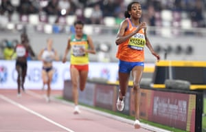 Sifan Hassan crosses the finish line to win the women's 10,000m final.
