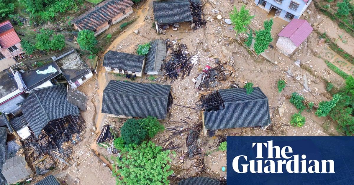 China landslide sweeps cars away as floods kill dozens – video