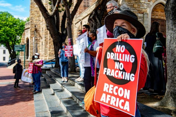 A silent protest against the drilling in the Kavango Basin on the steps of St George's Cathedral on 11 March in Cape Town, South Africa. Photograph: Gallo Images/Getty Images