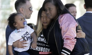 Salena Manni, center, the fiancee of police shooting victim Stephon Clark, holds the couple's son, Aiden as she is hugged by Cecilia McClenton at a rally calling for police reform on Saturday.