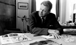 David Astor in his office with the first Observer Magazine in 1964.