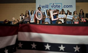 People listen as Democratic presidential nominee Hillary Clinton speaks during a North Carolina rally at Wake Technical Community College Tuesday in Raleigh, North Carolina.