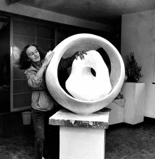 Hepworth with her work Sphere and the Inner Form, in her studio at St Ives in 1963.