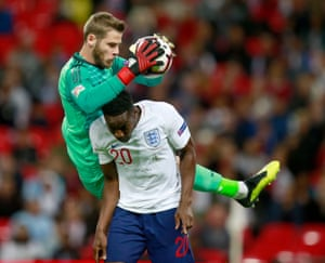 De Gea fumbles the ball under the challenge from Danny Welbeck.