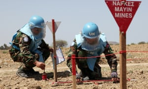 Experts demonstrating landmine clearance