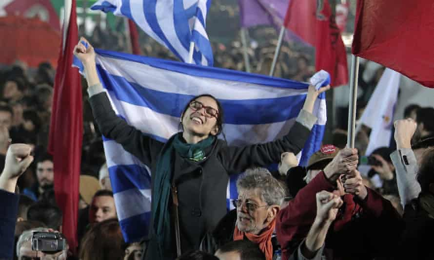 A Syriza supporter waves the Greek flag