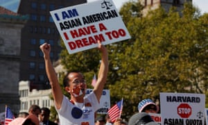 Demonstrators attend a rally ahead of the start of the trial in a lawsuit accusing Harvard University of discriminating against Asian American applicants, in Boston, Massachusetts, on Sunday.