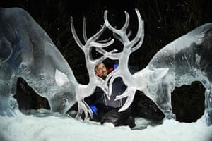 Two stags are frozen in time as they lock antlers, in another of Darren Jackson's creations.