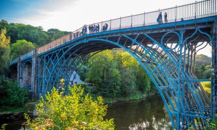 People walking over the Ironbridge in Shropshire UK