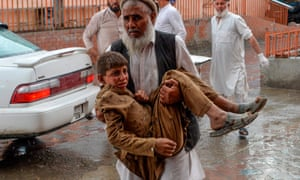 A volunteer carries an injured boy to hospital after the bombing.