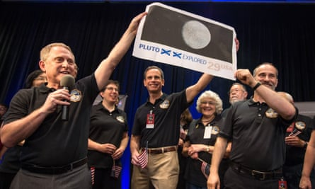 New Horizons principal investigator Alan Stern, left, celebrates the New Horizons mission with colleagues Ralph Semmel, centre, and Will Grundy.