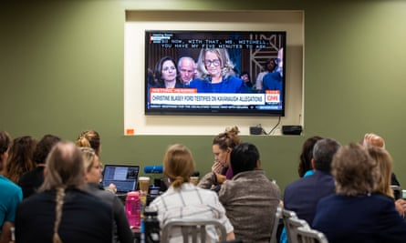 People in the Dirksen Senate office building watch Dr Christine Blasey Ford testify on 27 September.