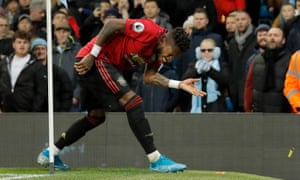 Fred reacts after cigarette lighters were thrown at him during the Manchester derby.