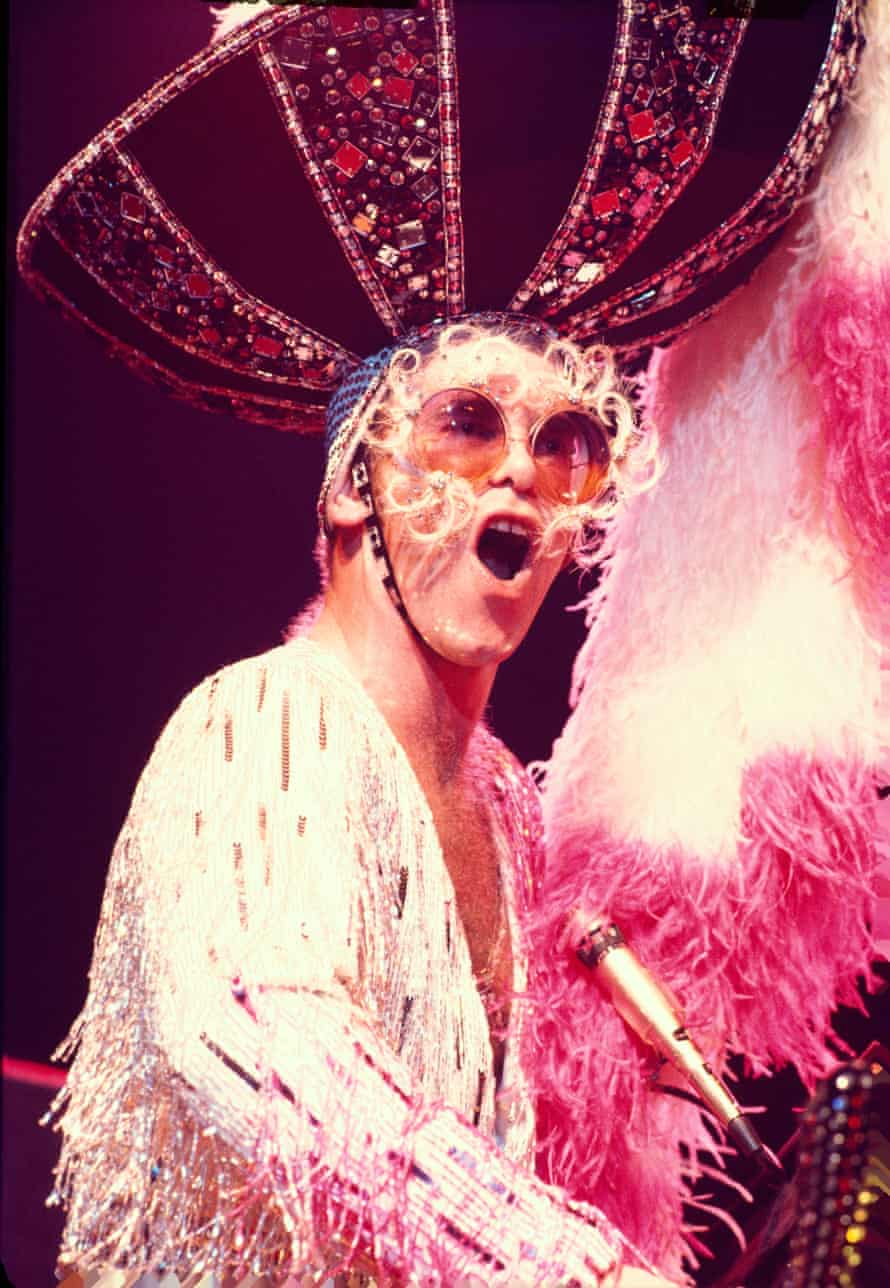 'Is there an actual human being behind the diva?' Elton John performing in 1974