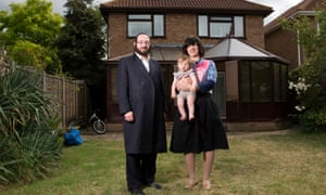 Joel and Mindy Friedman and daughter Malka outside their new home in Canvey Island.