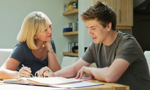 Mother helping son with work