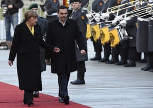 German Chancellor Angela Merkel (L) and Greek Prime Minister Alexis Tsipras review the honour guard during the welcomiing ceremony at the chancellery in Berlin, on March 23, 2015. AFP PHOTO / TOBIAS SCHWARZTOBIAS SCHWARZ/AFP/Getty Images