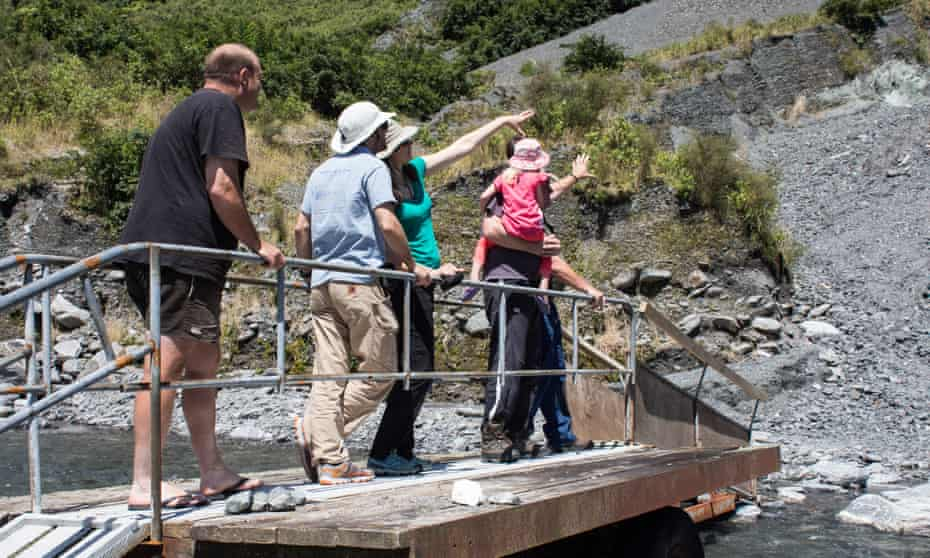 A tour group inspecting the fault which runs through the South Island of New Zealand.