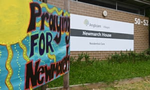 A sign saying Pray for Newmarch house outside the home