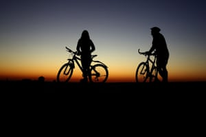 Munich, Germany Cyclists take their daily exercise as the sun rises