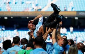 Pep Guardiola gets the celebration bumps.