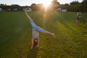 Emma Flanagan doing cartwheels while her parents cook a barbecue meal