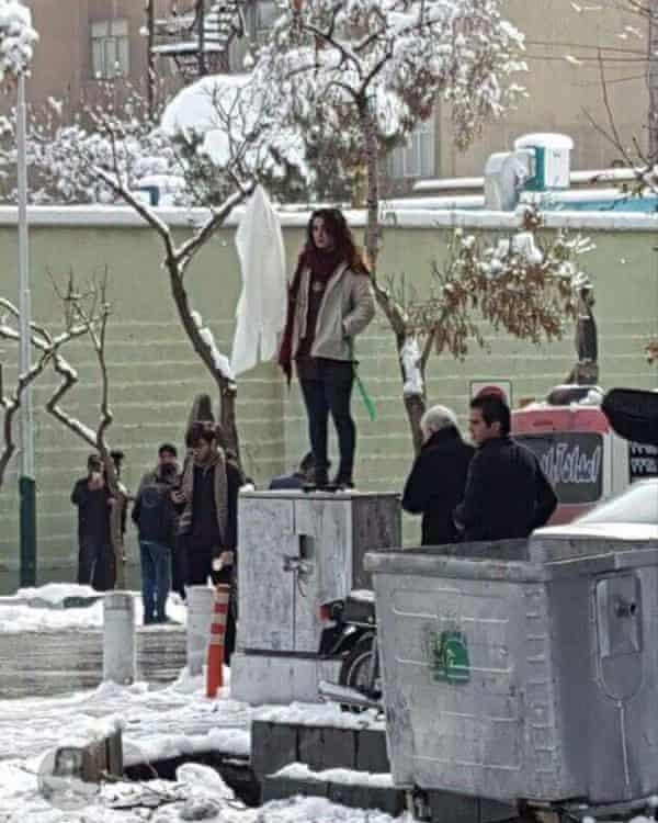 An unidentified woman protests in Iran against the compulsory hijab.