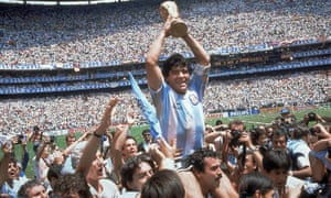 Diego Maradona holds up the trophy after Argentina beat West Germany 3-2 in their World Cup soccer final match at the Atzeca Stadium in Mexico City, 29 June 1986.
