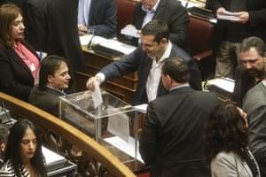 Greek Prime Minister Alexis Tsipras casting his ballot last night