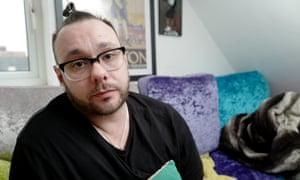 Robert Carver in his flat in Brighton