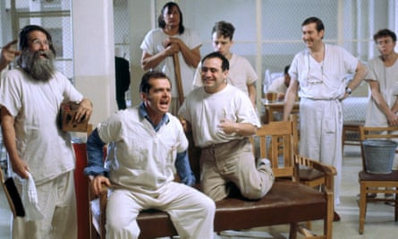 Jack Nicholson, seated, as Randle McMurphy in One Flew Over the Cuckoo's Nest (1975).