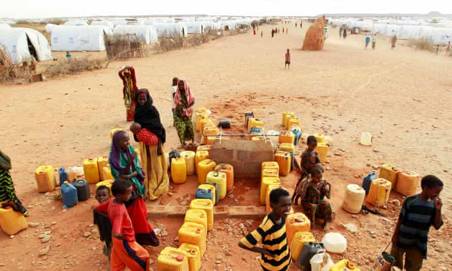 Somali refugees gather to collect water at the Kobe refugee camp, near the Ethiopia-Somalia border, during the 2011 famine