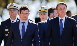 President Jair Bolsonaro and the justice minister, Sérgio Moro, arrive at a ceremony of the 154th anniversary of the Riachuelo naval battle at the marine corps headquarters in Brasília on Tuesday.