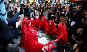 Extinction Rebellion's protest outside a fashion week venue in London.