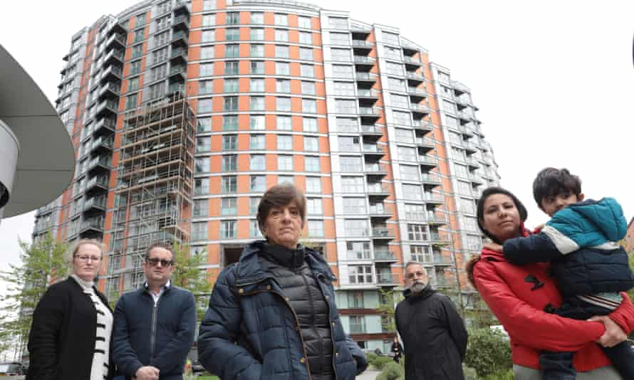 New Providence Wharf residents In front of the housing block in which there was a fire last week. Left to right: Joanne and Andrew McCallum, Yasmin Naqushbandi, Colin Gold, Misha Intwala and son Aarin.