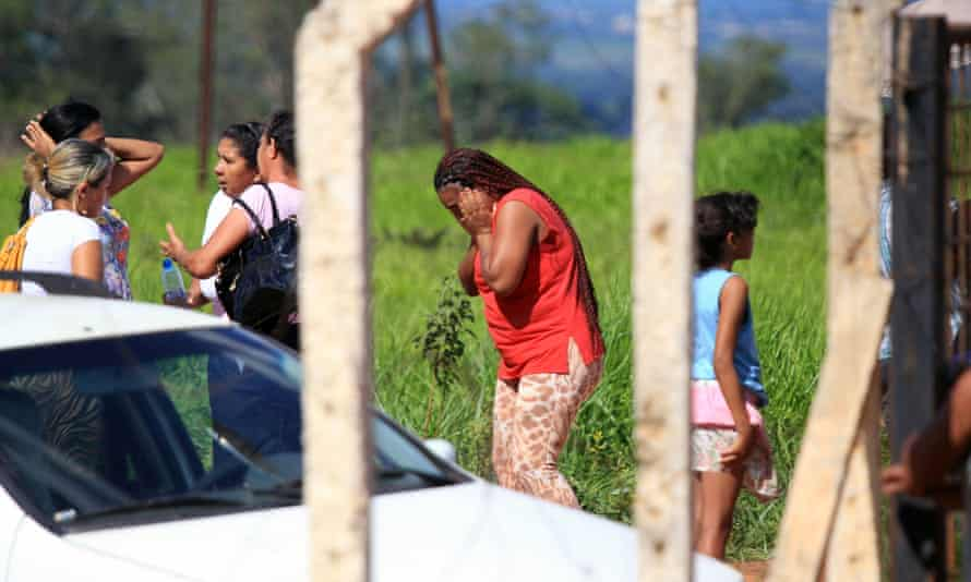 Relatives waiting for information outside the state prison in Goiás, Brazil, on 1 January.